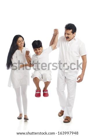 Couple having fun with their son - stock photo