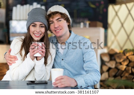 Couple having hot drink on winter day
