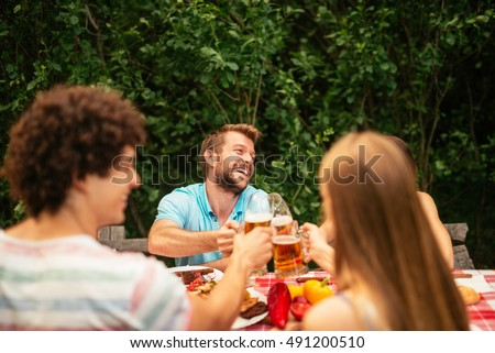 Couple having lunch on a picnic outdoors.