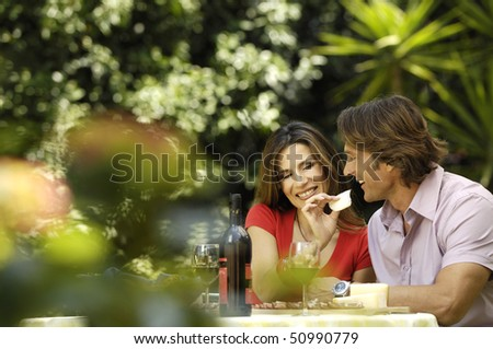 couple having meal in the garden - stock photo