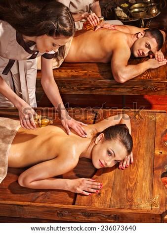 Couple  having oil Ayurveda spa treatment. - stock photo