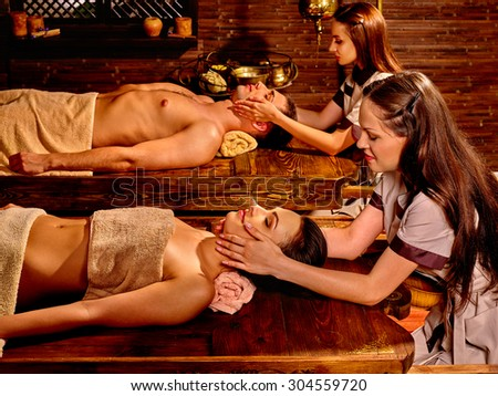 Couple  having oil Ayurveda spa treatment. Spa resorts in India - stock photo
