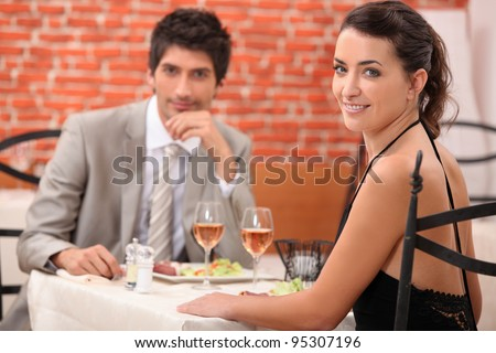 Couple having romantic meal in restaurant