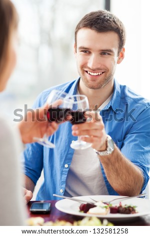 Couple having toast in restaurant - stock photo