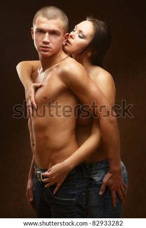 couple heterosexual topless with jeans detail studio shot