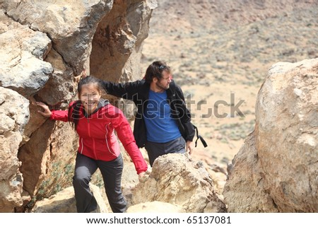 Couple hiking on Tenerife on the volcano Teide.
