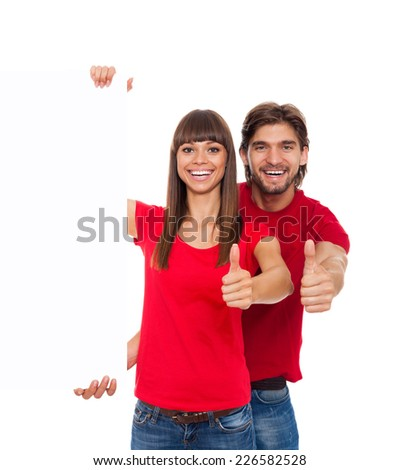couple hold thumb up gesture white board with empty copy space, concept of advertise shopping sale, wear red shirts, isolated over white background - stock photo