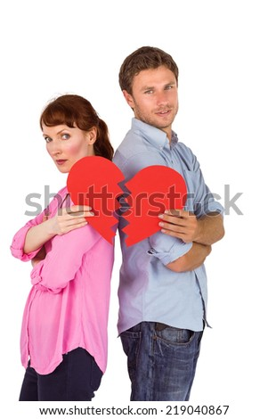 Couple holding a broken heart on white background