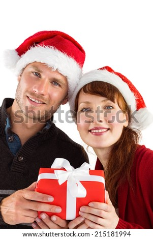 Couple holding a christmas gift on white background