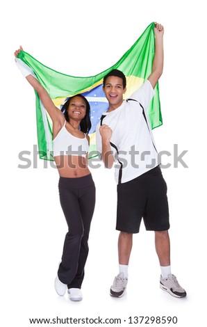 Couple Holding Brazil Flag Over White Background - stock photo