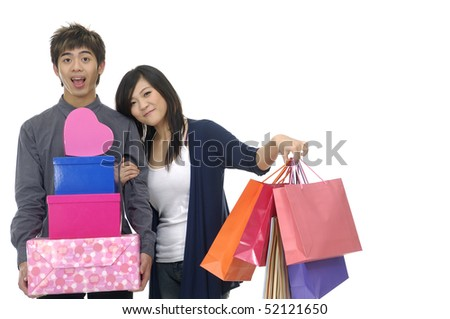 Couple holding gifts box and shopping bag