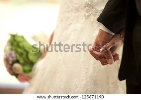 Couple holding hands - stock photo