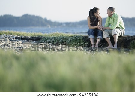 Couple holding hands and talking