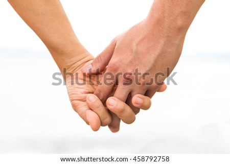 Couple Holding Hands at Sea. (Soft focus)