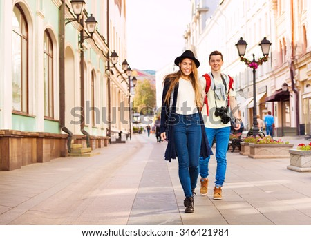 Couple holding hands during walking on the street - stock photo