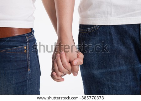 Couple Holding hands in studio