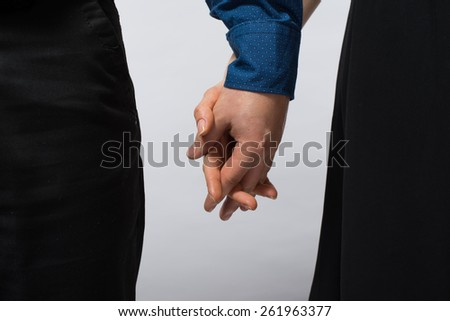 Couple holding hands. Man and woman holding hands,