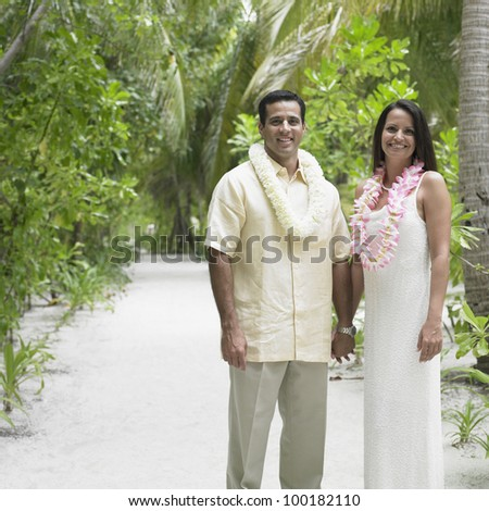 Couple holding hands outdoors - stock photo
