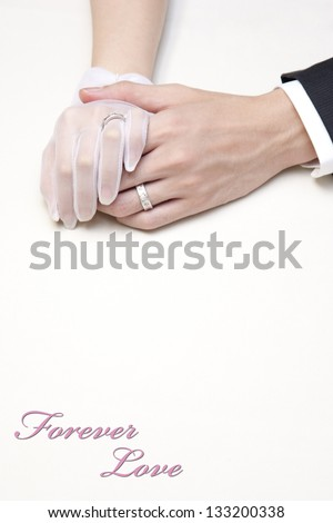 Couple holding hands with 'Forever love' - stock photo