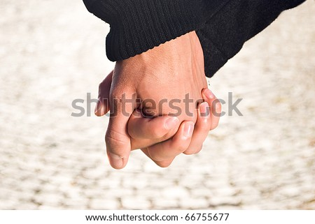 Couple holding their hands