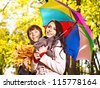 Couple holding umbrella  autumn outdoor. - stock photo