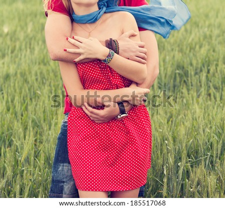 Couple hugging in a green land - stock photo