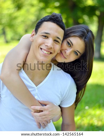Couple hugging in a park - stock photo