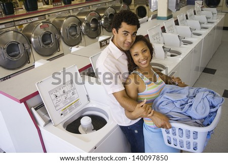 Couple hugging in laundromat