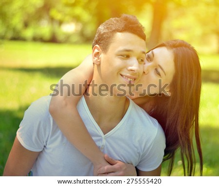 Couple hugging in park - stock photo