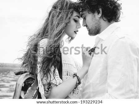 Couple hugging outdoor black and white