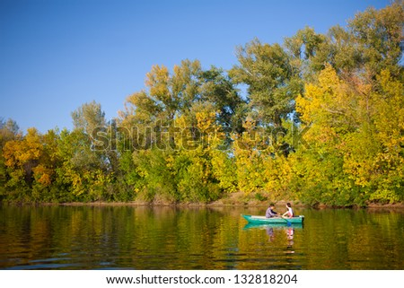 couple in a boat outdoors - stock photo