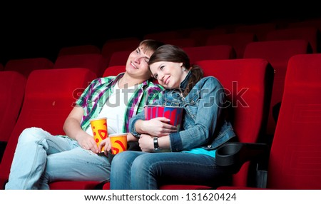 couple in a movie theater, watching a 3D movie