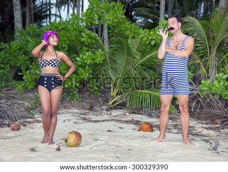 couple in a retro swimsuit on the beach  - stock photo