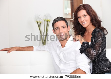 couple in a sofa - stock photo