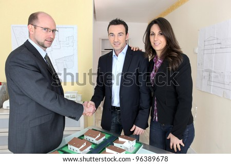 Couple in an architect's office - stock photo