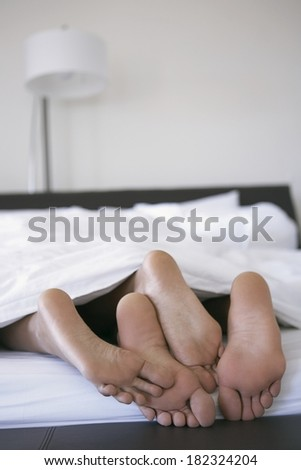 Couple in bed at morning