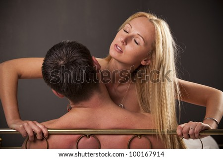 Couple in bed making sex - stock photo
