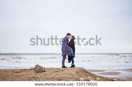 Couple in blanket on the sea valentines day