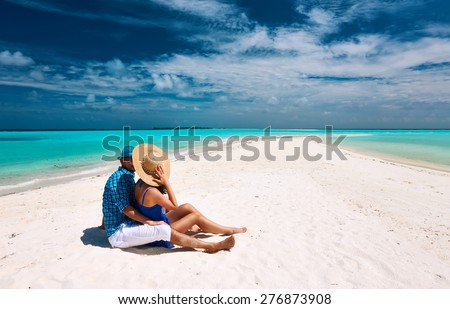 Couple in blue on a tropical beach at Maldives - stock photo