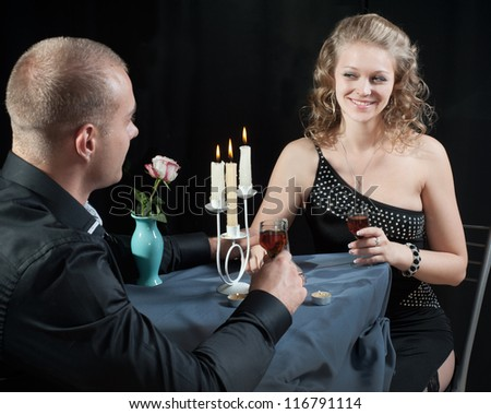 Couple in cafe for romantic dinner - stock photo