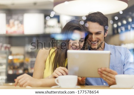Couple in cafe with digital tablet  - stock photo