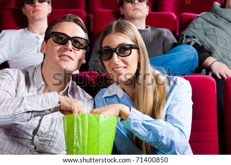 Couple in cinema watching a movie in 3D - stock photo