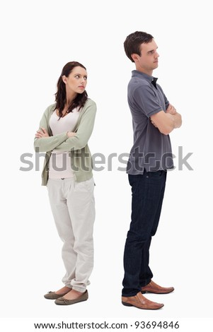 Couple in disagreement against white background - stock photo