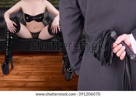 Couple in erotic bed scene. - stock photo