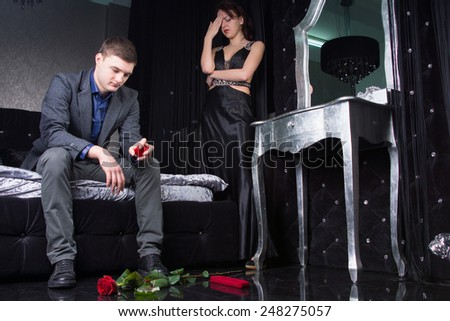 Couple in Formal Wear Having Argument Ignoring Each Other with Roses on Ground