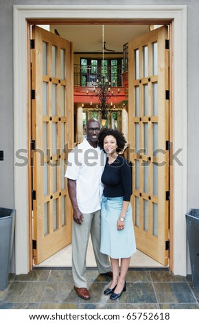 Couple in front of house - stock photo