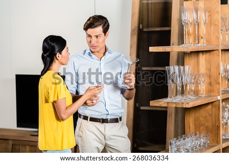 Couple in furniture store  - stock photo