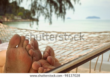 couple in hammock - stock photo
