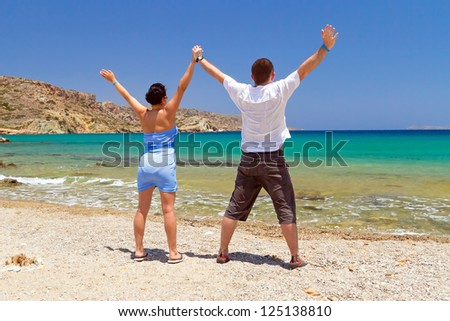 Couple in happiness at the sea of Greece - stock photo