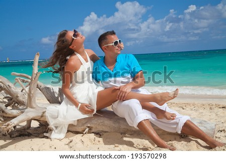 Couple in hug dreaming together in Caribbean beach.